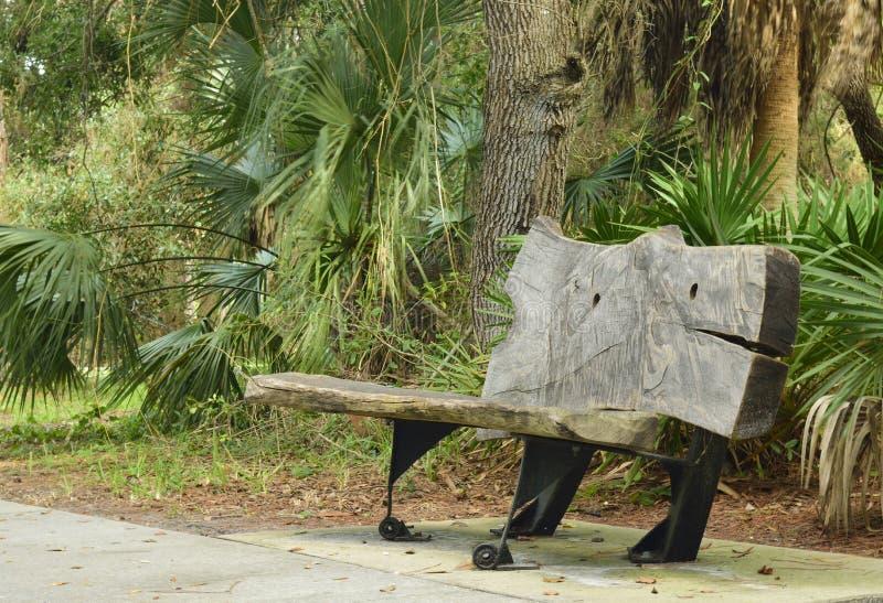 Unique park bench. Along a walk in a park stock photos