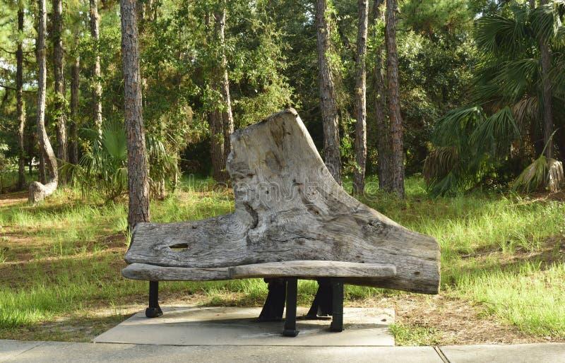 Unique park bench. Along a walk in a park stock image