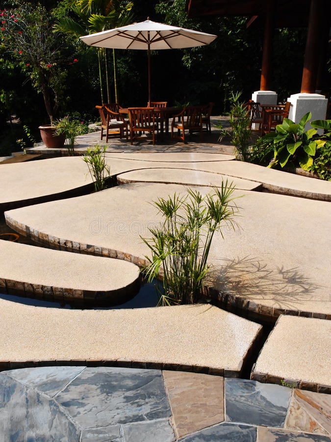 Unique patio design, stone slabs over water stock photos