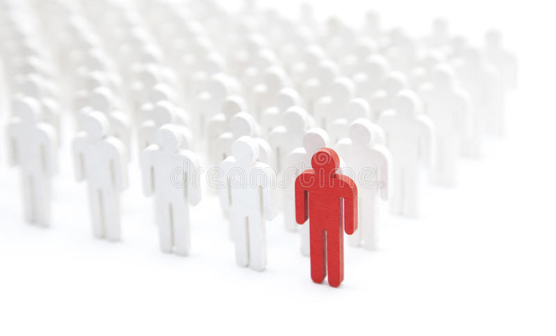 Unique person in the crowd. Unique red person in the crowd of white people figures stock photos