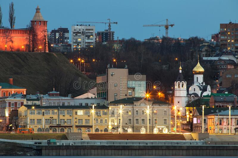 A unique perspective of Nizhny Novgorod in the evening with the city lights. On against the backdrop of a beautiful sky and sunset stock images