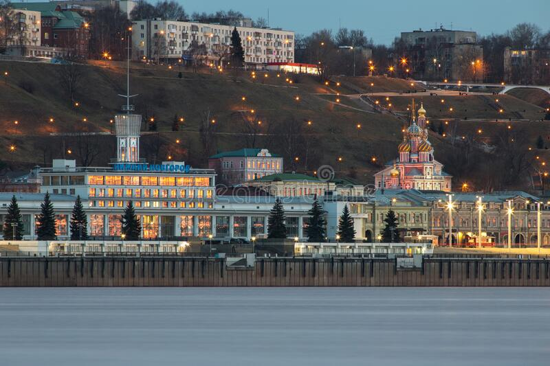 A unique perspective of Nizhny Novgorod in the evening with the city lights. On against the backdrop of a beautiful sky and sunset royalty free stock images