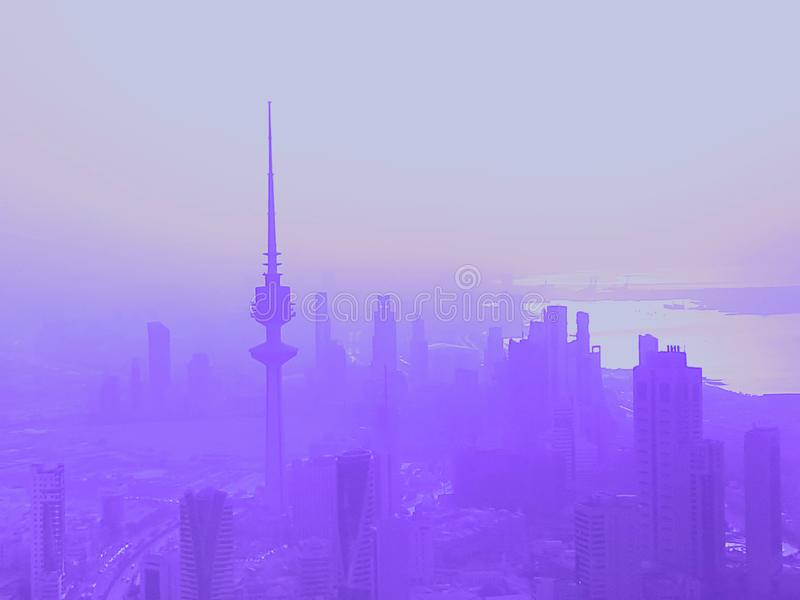 Purple Skyline Of Kuwait City At Dusk. Unique Purple Filtered Skyline Of Kuwait City At Dusk royalty free stock photography