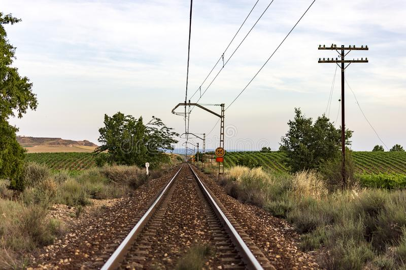 Unique railroad line at the sunset. Train railway track . Low clouds over the railroad royalty free stock photo