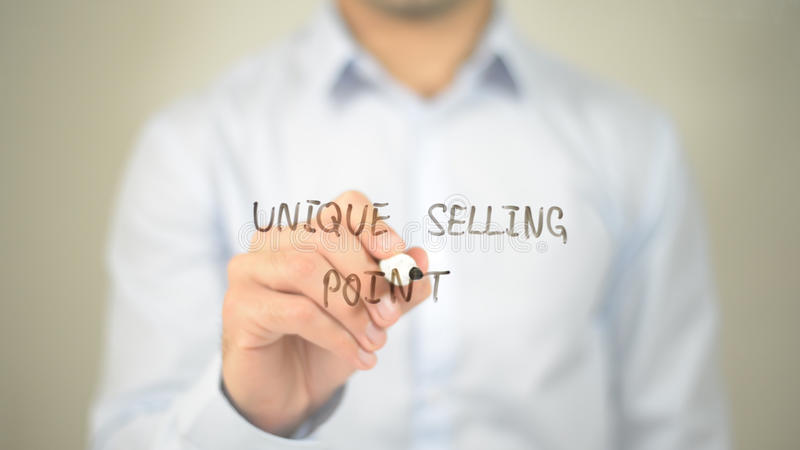 Unique Selling Point , man writing on transparent screen royalty free stock image