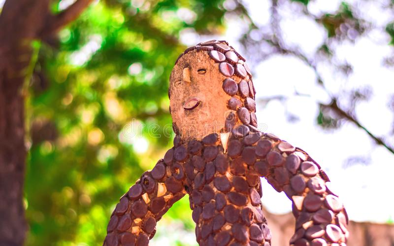UNIQUE STATUE OF BOY MADE WITH COL DRINK CAPS stock photography