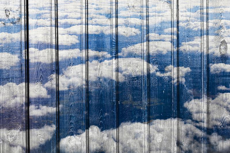 Unique structure, wooden background and clouds royalty free stock photos