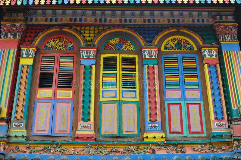 Unique traditional colorful windows in Little India, Singapore. Colorful facade of building in Little India, Singapore which is deep in traditional culture value stock photo