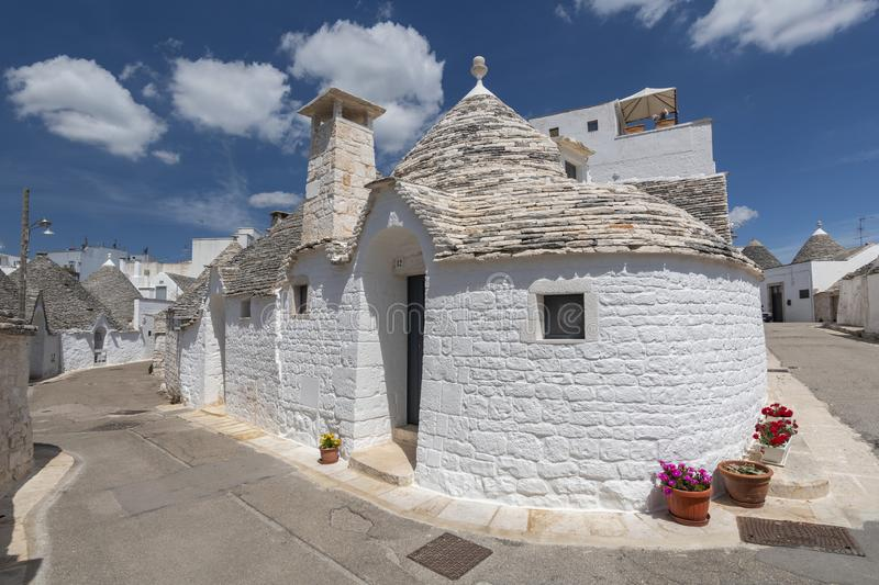 Unique Trulli houses, traditional Apulian dry stone hut with a conical roof in Alberobello, Puglia, Italy.  royalty free stock photos