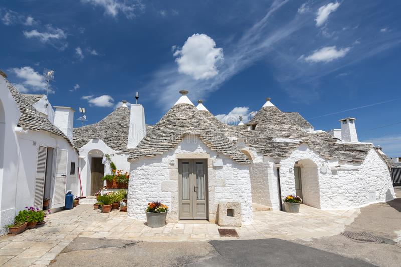 Unique Trulli houses, traditional Apulian dry stone hut with a conical roof in Alberobello, Puglia, Italy.  royalty free stock photo