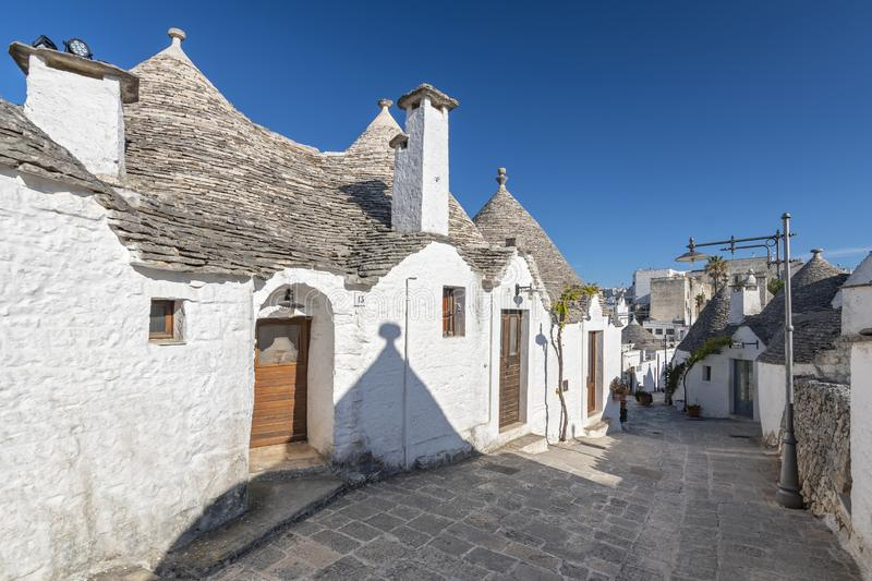 Unique Trulli houses, traditional Apulian dry stone hut with a conical roof in Alberobello, Puglia, Italy.  stock images