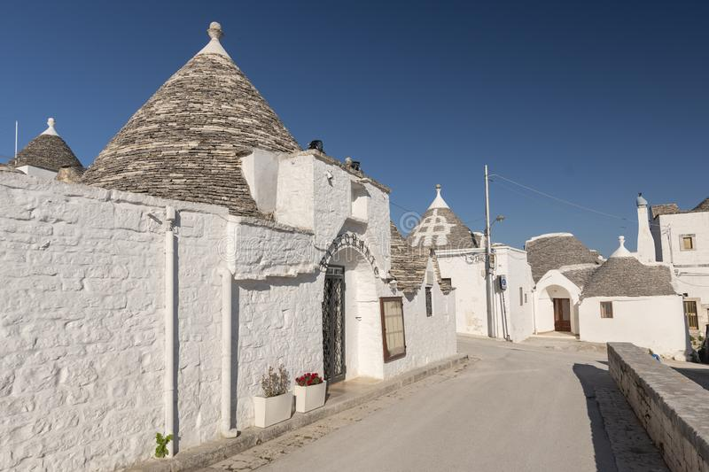 Unique Trulli houses, traditional Apulian dry stone hut with a conical roof in Alberobello, Puglia, Italy.  royalty free stock photography