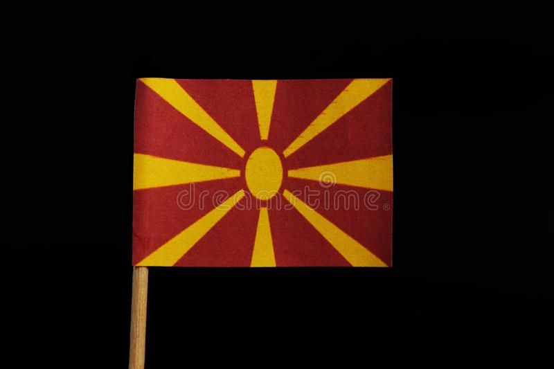 A unique and very original, national flag of the Republic of Macedonia on toothpick on black background. Stylised yellow sun on stock images
