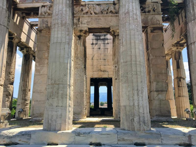 A unique view looking through the columns of the doric columns of The Temple of Hephaestus or Hephaisteion. Or earlier as the Theseion, which is a well royalty free stock photography