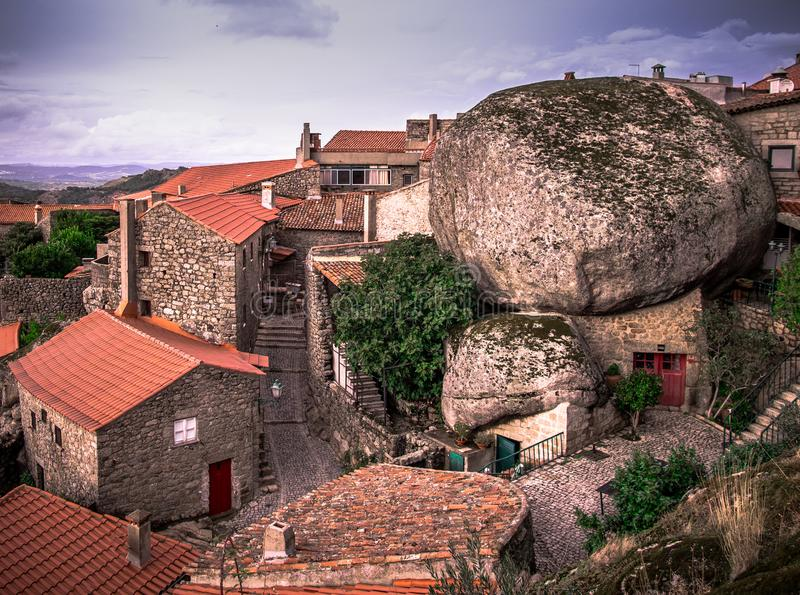 Unique village of Monsanto Portugal, with giant stone boulder construction. The amazing medieval village of Monsanto, Portugal. Its buildings incorporate the stock image