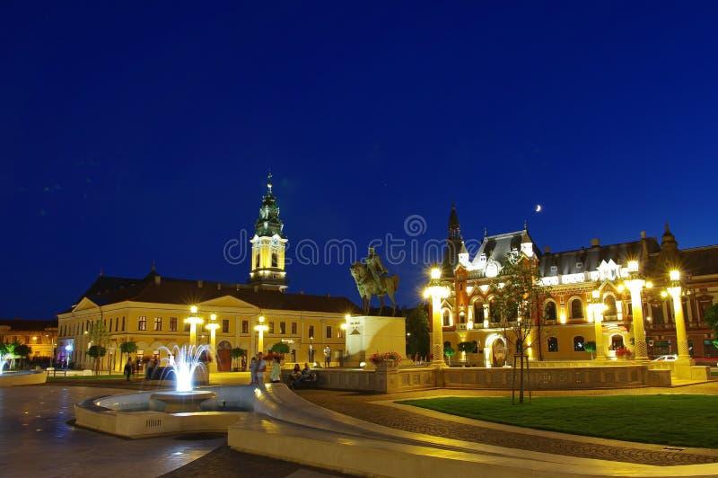 Unirii Square in Oradea - statue of Romanian Hero Mihai Viteazu. Unirii Square with the statue of Romanian Hero Mihai Viteazul, the St. Ladislau Baroque Church stock image
