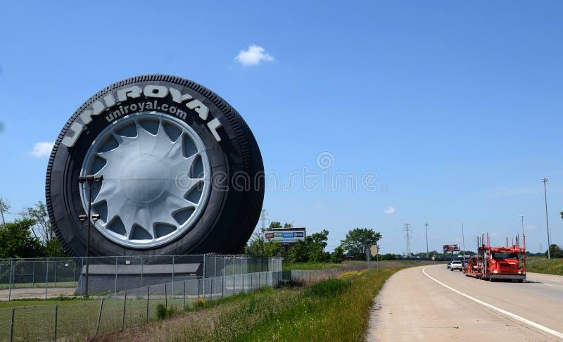 Uniroyal Giant Tire near Detroit, MI. ALLEN PARK, MI - JULY 6: The Uniroyal Giant Tire, off Interstate I-94 near Detroit Metropolitan Airport, is shown here on royalty free stock images