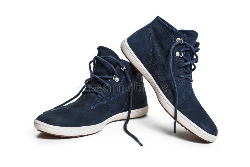 Unisex-schoenen over wit stock foto
