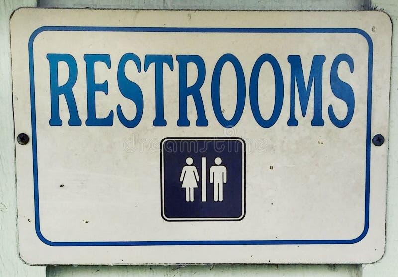 Unisex toaleta metalu znak obrazy royalty free