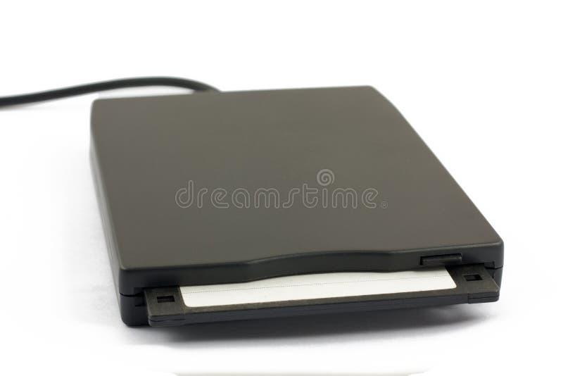 Unité de disquettes d'USB avec le disque sur le blanc photo stock