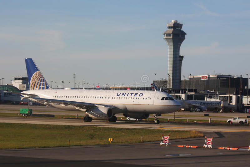United Airlines Airbus A320 plane on tarmac at O'Hare International Airport in Chicago. CHICAGO, ILLINOIS - OCTOBER 25, 2015:United Airlines Airbus A320 plane on royalty free stock image