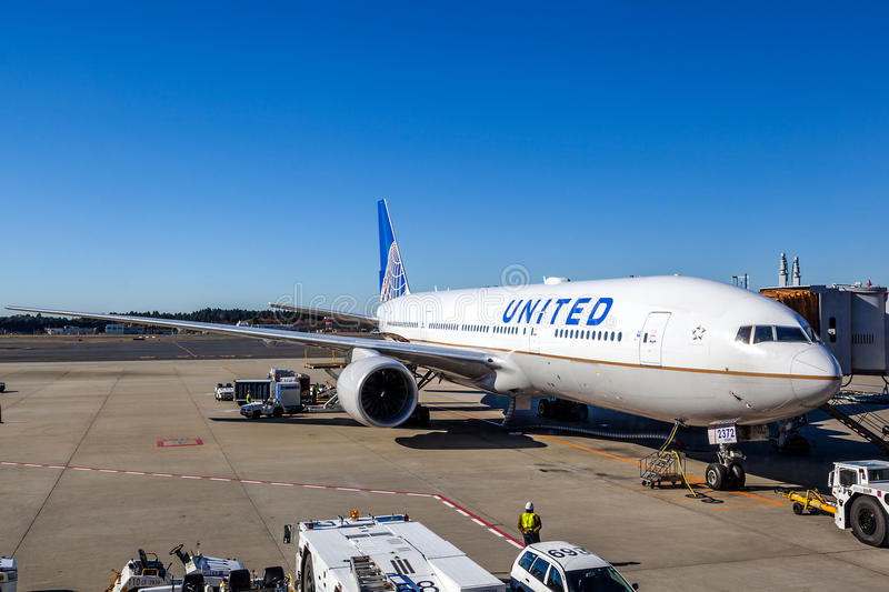 United Airlines on the Tarmac of Narita Airport. A United Airlines plane being serviced on the tarmac of Narita Airport. After its merger with Continental in stock photo