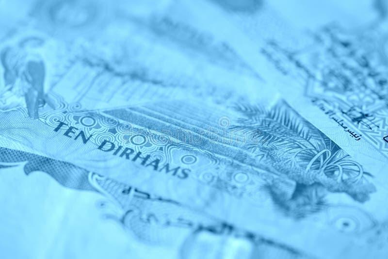 United Arab Emirates banknotes, blue color toned. United Arab Emirates banknotes close up blue color toned royalty free stock image