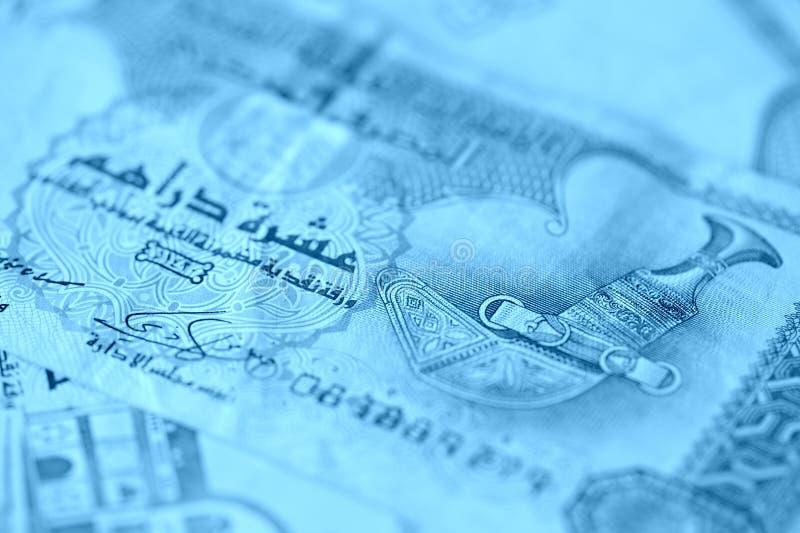 United Arab Emirates banknotes, blue color toned. United Arab Emirates banknotes close up blue color toned stock image
