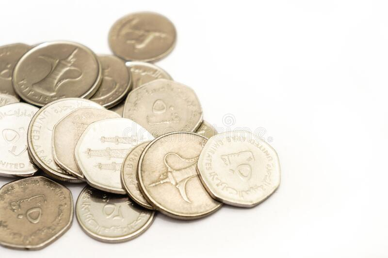 United Arab Emirates cash and coins. United Arab Emirates cash notes and coins isolated on white background. selective focus. high key stock photos