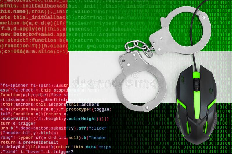 United Arab Emirates flag and handcuffed computer mouse. Combating computer crime, hackers and piracy. United Arab Emirates flag and handcuffed modern backlit stock image