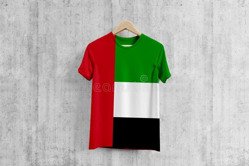 United Arab Emirates flag T-shirt on hanger, UAE team uniform design idea for garment production. National wear.  stock images