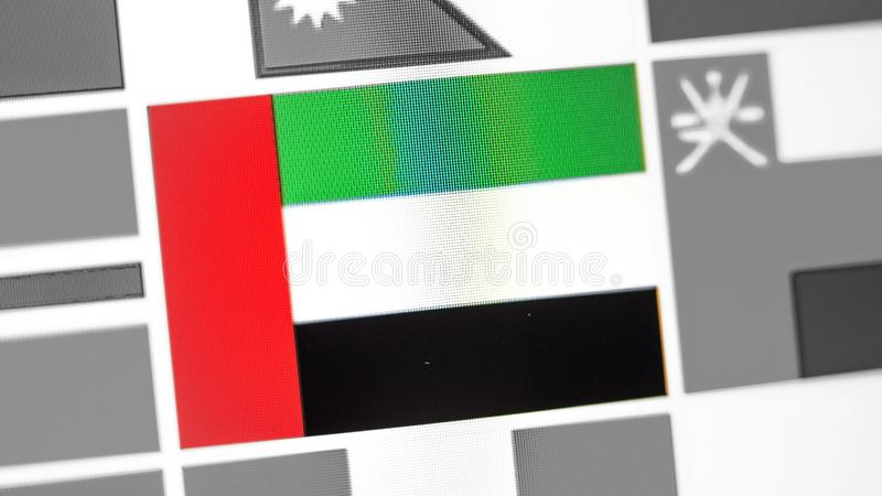United Arab Emirates national flag of country. UAE flag on the display, a digital moire effect. News of geography and geopolitics royalty free stock photo