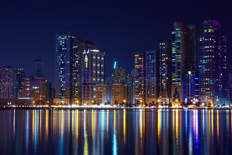 United Arab Emirates, Sharjah skyline at night. Reflection at Khalid Lake stock photo