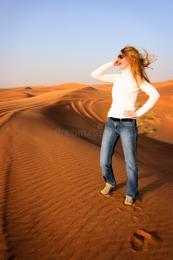 United Arab Emirates: Tourist in Desert. Female tourist is admiring the beautiful desert near Dubai in United Arab Emirates stock photography