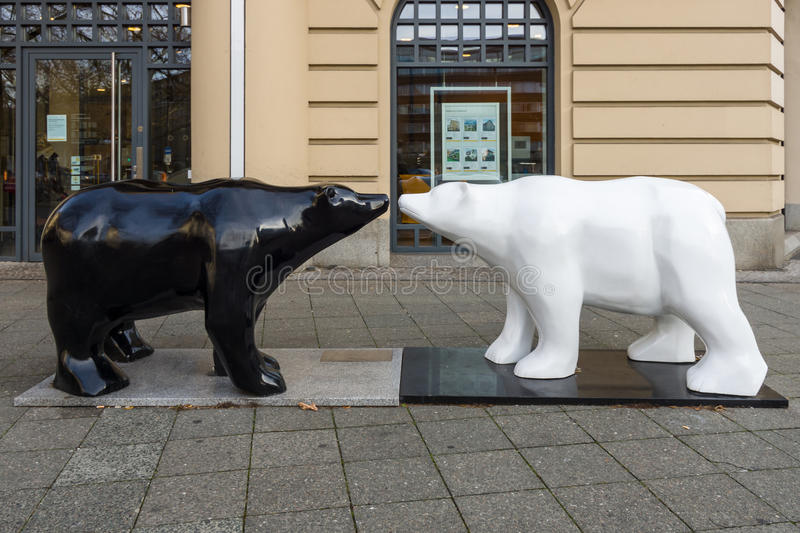 United Buddy Bears. BERLIN - DECEMBER 08, 2016: Installation of the `Black and white bears` United Buddy Bears before the office of Commerzbank on the famous royalty free stock image