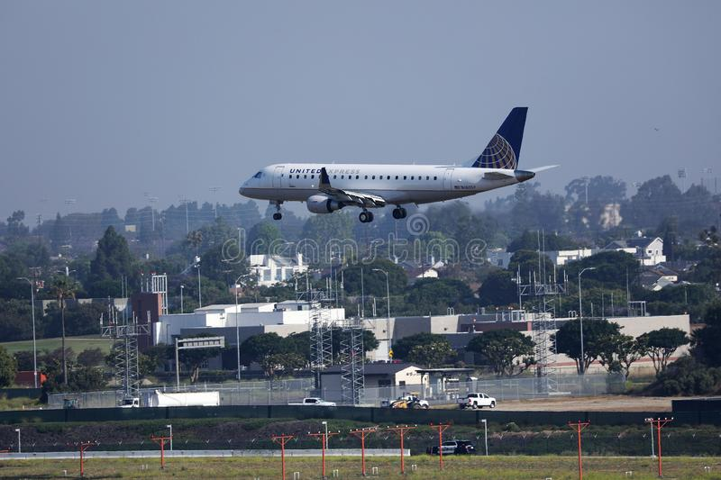 United Express airplane approaching Los Angeles Airport, LAX stock photos