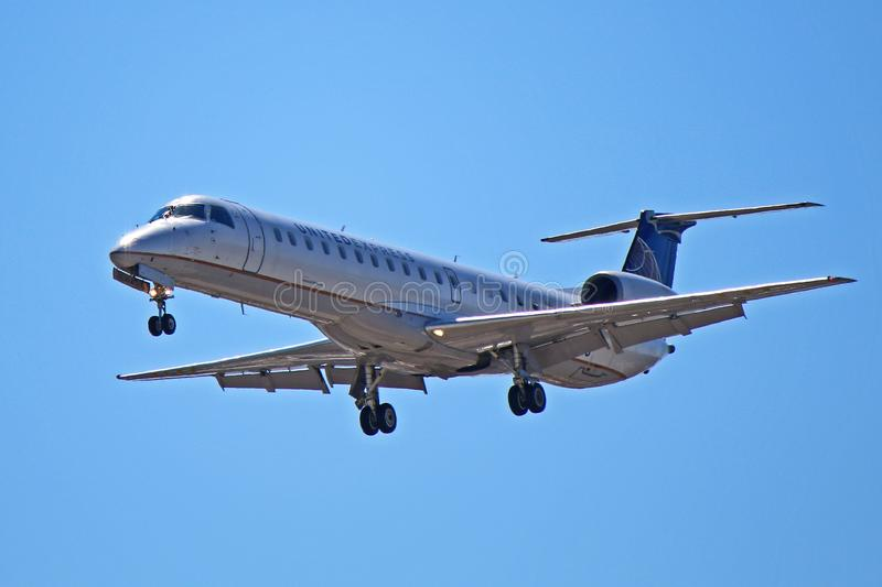 United Express Embraer ERJ-145LR Front View. A United Express Embraer ERJ-145LR seen on final approach to Toronto Pearson International Airport YYZ. This Embraer stock image