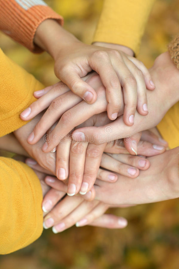United hands on autumn background royalty free stock photos