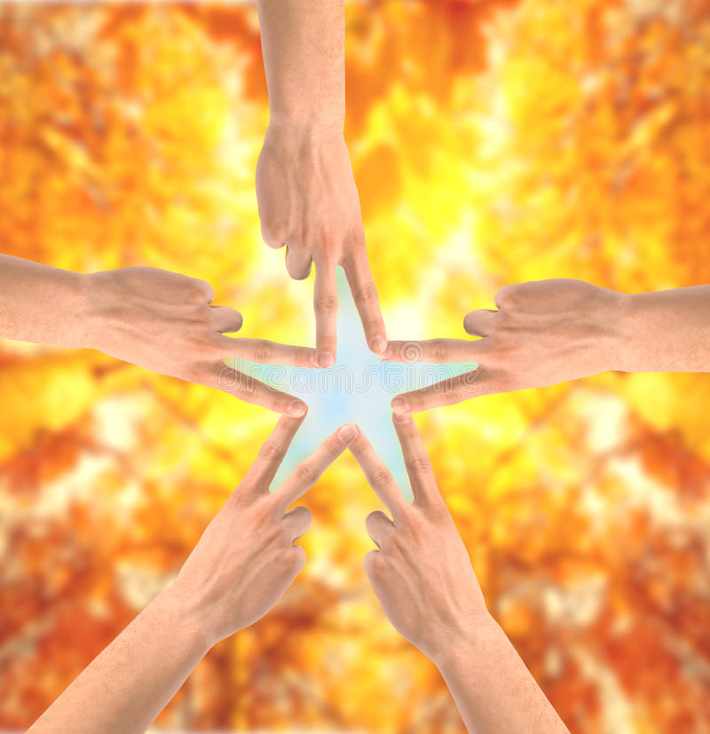 United hands over bright nature background. Conceptual photo of teamwork stock photography