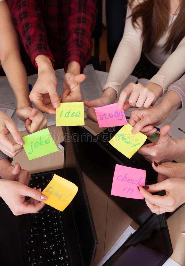 United hands stickers lesson school table computer business team work space top view class mate group royalty free stock images