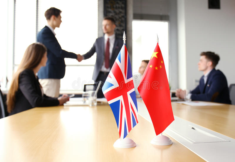 United Kingdom and Chinese leaders shaking hands on a deal agreement. United Kingdom and Chinese leaders shaking hands on a deal agreement royalty free stock photo