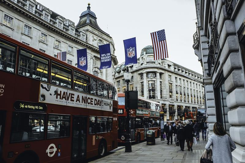 United Kingdom, England, London - 2016 October 06: Popular tourist Regent street with United States and NFL flags. Due to celebration of Super Bowl event. This stock images