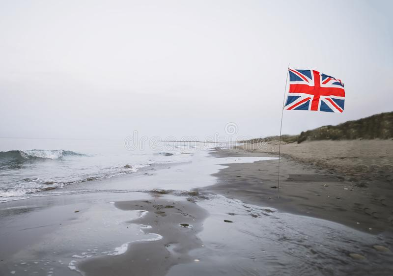 United Kingdom flag on the beach. Borders and Brexit Concept royalty free stock photo
