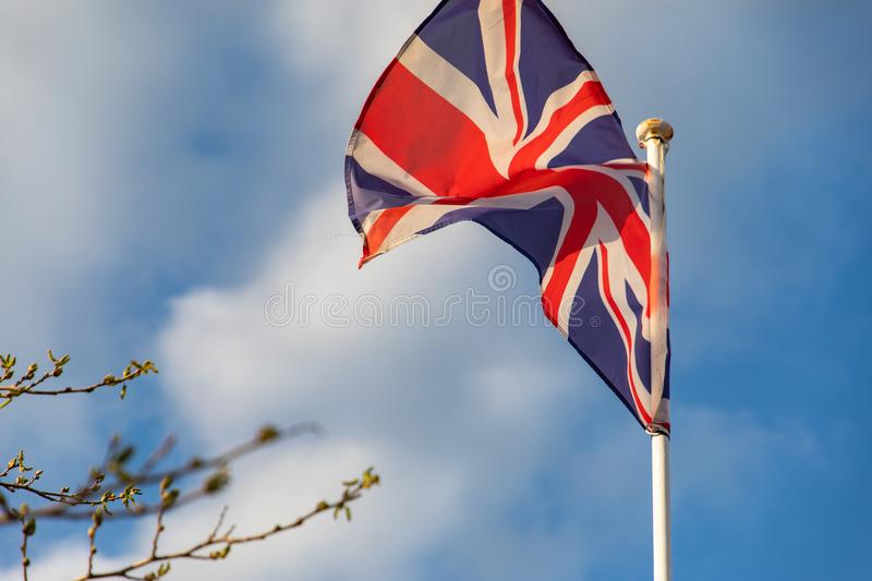 United Kingdom flag waving on the wind. With copy space royalty free stock image