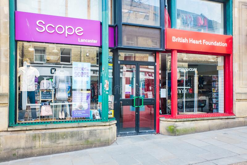 UNITED KINGDOM, LANCASTER - 9TH APRIL 2020 Exterior of Scope and BHF shop shop during lockdown for Covid 19. Virus stock images