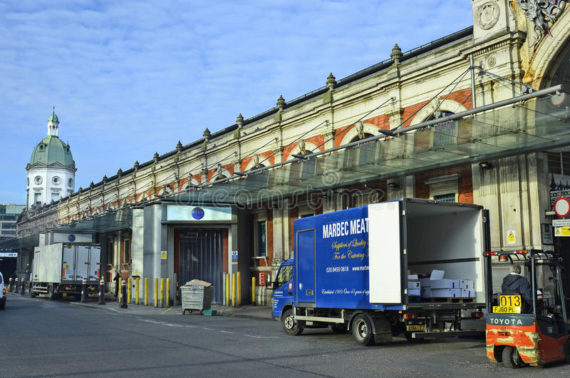United Kingdom-London. London, United Kingdom - January 19th 2016: trucks for delivery in front of Smithfield market building royalty free stock photos
