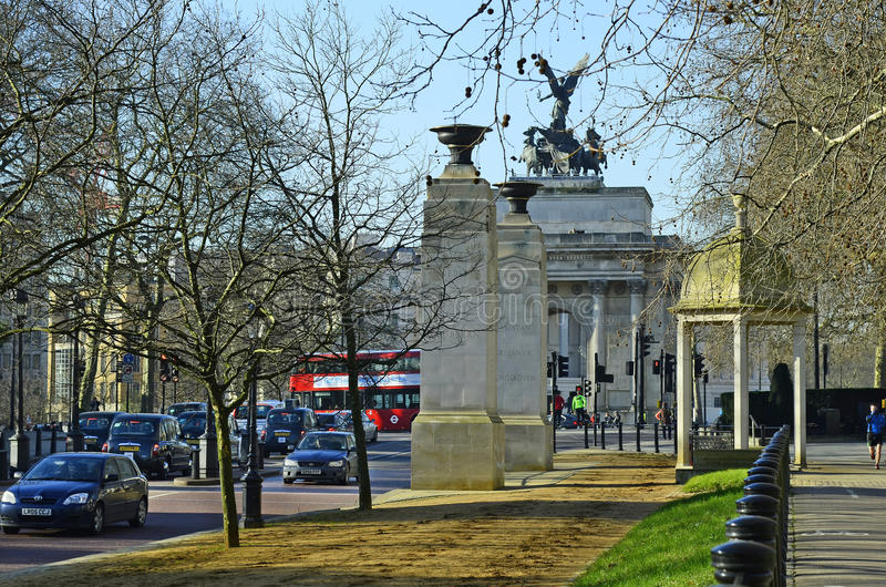 United Kingdom-London. London, United Kingdom - January 19th 2016: Unidentified people and traffic around Wellington arch and memorial gates stock photos