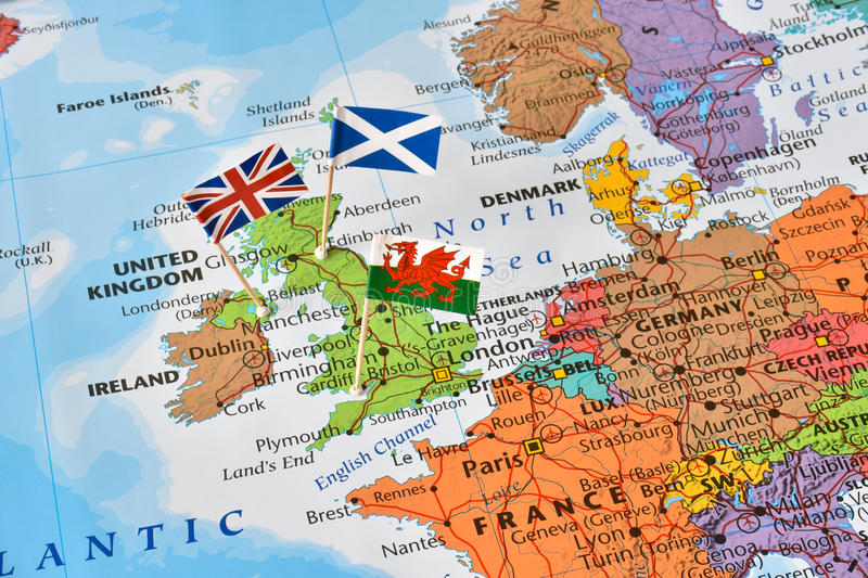 United kingdom map, flags of England, Scotland, Wales, brexit concept. Paper flag pins of England, Scotland, Wales, and Northern Ireland which form the United royalty free stock photo