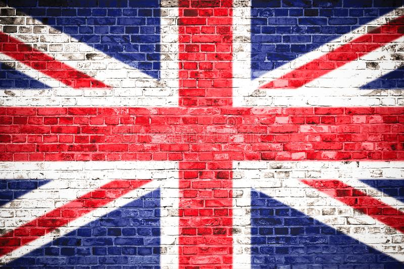 United Kingdom UK flag painted on a brick wall. Concept image for Great Britain, British, England, English language, people royalty free stock photo