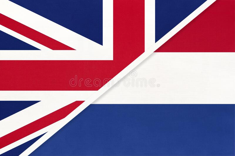 United Kingdom vs Netherlands national flag from textile. Relationship between two european countries. United Kingdom of Great Britain and Ireland vs Netherlands stock photos